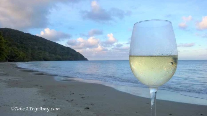 Enjoying a drink at Cape Tribulation, where the rainforest meets the Ocean, QLD, Australia
