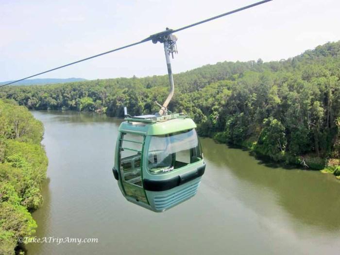 Kuranda Gondola Ride over lush tropical rainforest .