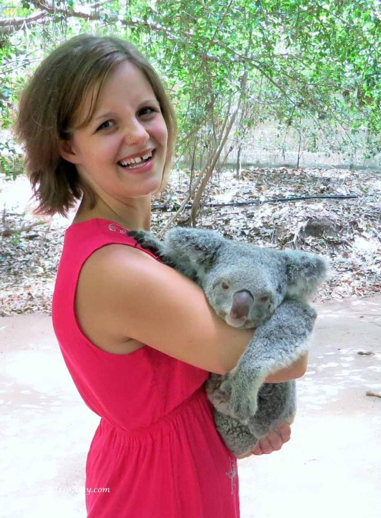 Cuddling Pebbles the Kola at Bungalow Bay Koala Village, Magnetic Island, QLD, Australia