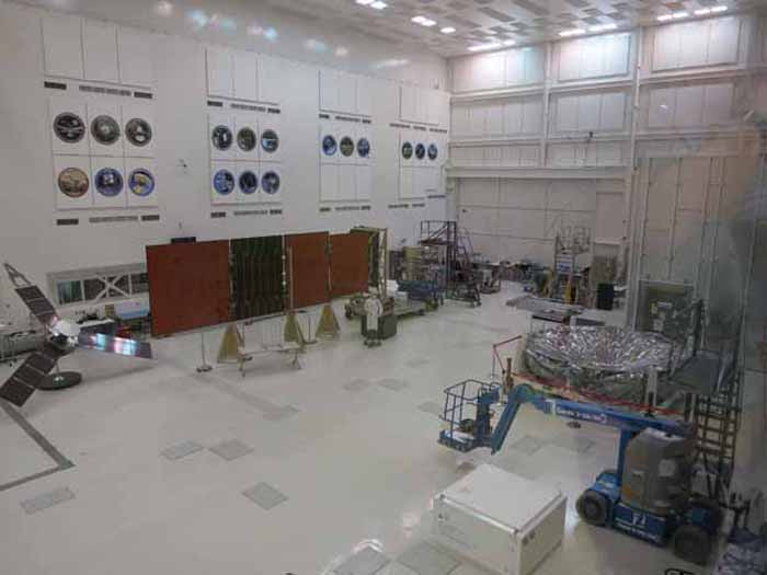 Clean room where spacecraft is built to minimize any Earth contamination. Notice the mannequin in the center of the room to get an idea of the size of this room.