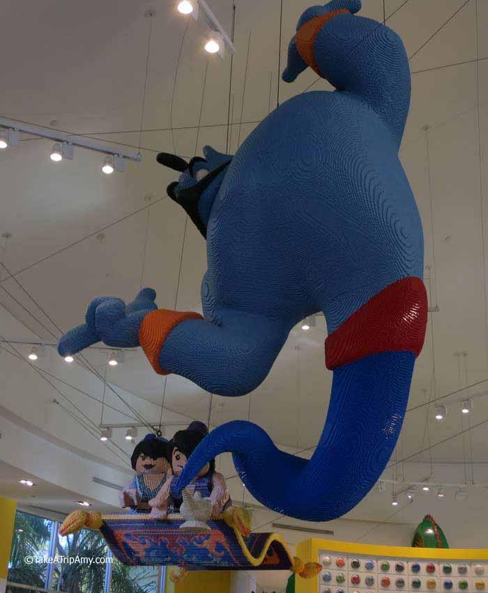 Genie, Aladdin, and Jasmine on magic carpet. Downtown Disney LEGO® Store, Anaheim, CA, USA
