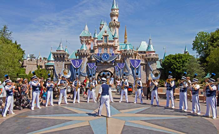 Disneyland's marching band performs Disney tune favorites in front of Sleeping Beauty's Castle.